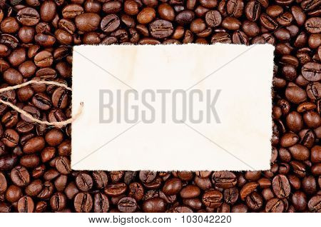 Empty paper on roasted coffee beans, can be used as background