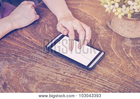 Close Up Of Hands Woman Using Phone In Coffee Shop