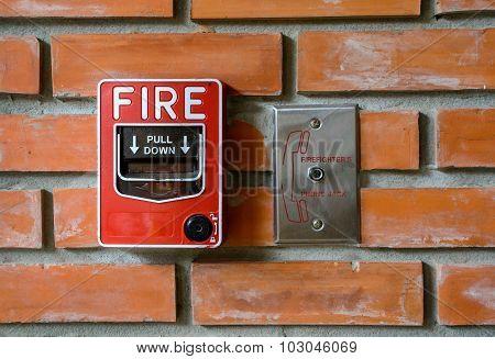 Fire Break Glass Alarm Switch On Brick Wall