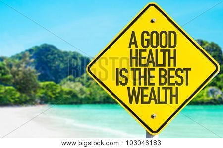A Good Wealth Is The Best Wealth sign with beach background