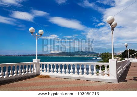 White Embankment, Azure Sea, Blue Sky