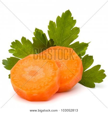 Chopped carrot slices and parsley herb leaves still life isolated on white background cutout