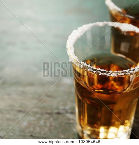 Tequila shots with salt on rustic  background
