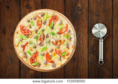 Delicious Seafood Pizza With Tomatoes And Cutter