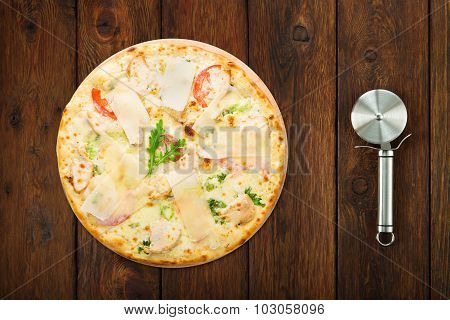 Delicious Pizza With Chicken, Parmesan And Arugula And Cutter