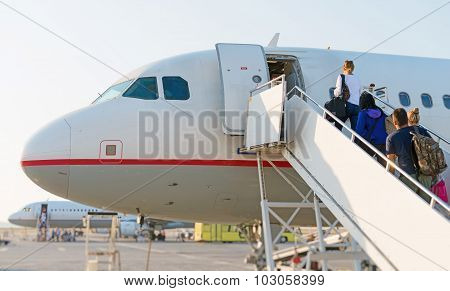 Airplane Boarding. Passengers Climb The Ladder.