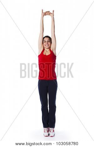 Young woman exercising and stretching (isolated on white)