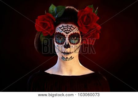 Woman in professional halloween santa muerte mask.