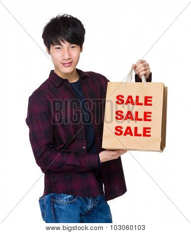 Young Man hold with shopping bag for showing three sale words