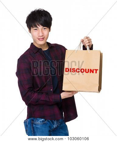 Young Man hold with shopping bag for showing a word discount