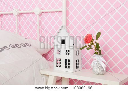 Detail bedroom with flower on nightstand