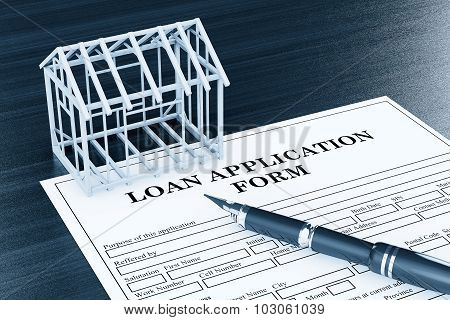 Loan Application Form With House Frame And Pen