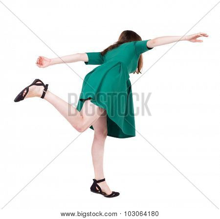 Balancing young woman.  or dodge falling woman. Rear view people collection.  backside view of person.  Isolated over white background. Girl in green short dress falls forward.