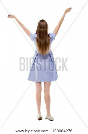 Back view of beautiful woman welcomes. Young teenager girl in jeans hand waving from. Rear view  people collection.  backside view of person.  Isolated over white background. girl in blue dress prays