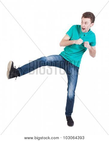 skinny guy funny fights waving his arms and legs. Isolated over white background. Funny guy clumsily boxing. The guy shouts waving foot