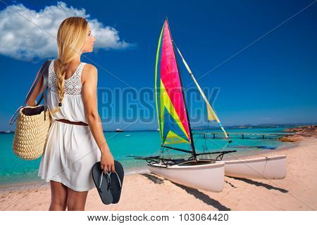 Blond tourist in a beach with basket and flip flops at Formentera photomount