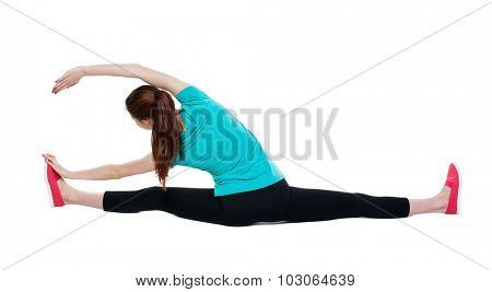 back view of standing young beautiful  woman in sport dress  involved in Pilates. Rear view people collection.  backside view of person.  Isolated over white background.