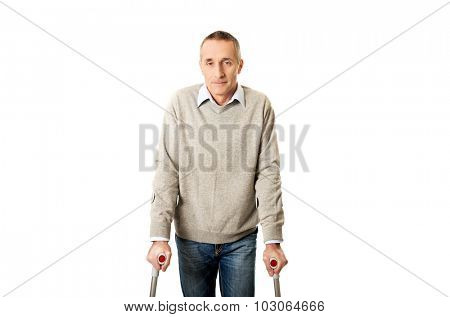 Disabled mature man with crutches.