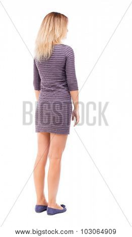back view of standing young beautiful  woman.  girl  watching. Rear view people collection.  backside view of person.  Isolated over white background. A girl in a purple dress stands sideways