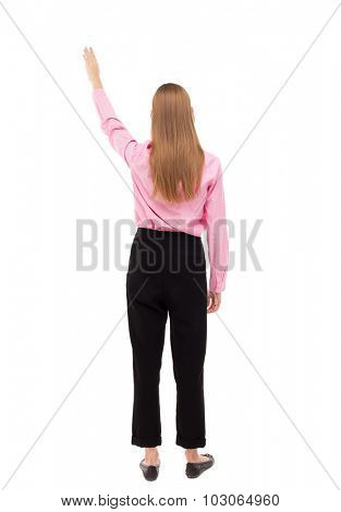 Back view of  pointing woman. beautiful girl. Rear view people collection.  backside view of person.  Isolated over white background. Girl in office attire stands raised his left arm up.