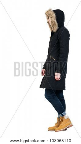 Back view of going  woman in parka. walking young girl. Rear view people collection.  backside view of person.  Isolated over white background. Past us is a girl in a winter jacket