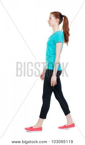 side view of walking  woman in sports tights. beautiful girl in motion.  backside view of person.  Rear view people collection. Isolated over white background.  Sports girl goes to the right.