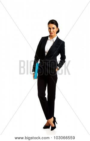 Smiling businesswoman holding a binder.