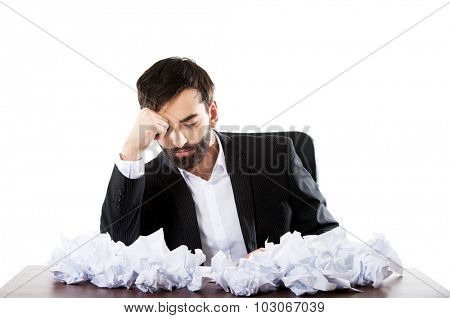 Young worried businessman can't find an idea.