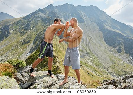 Kickboxers Or Muay Thai Fighters Training In The Mountains