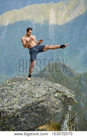 Kickboxer Or Muay Thai Fighter Training On A Mountain Cliff