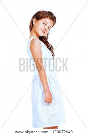Pretty eight-year girl wearing white dress. Studio shot. Kid's beauty, fashion. Isolated over white.