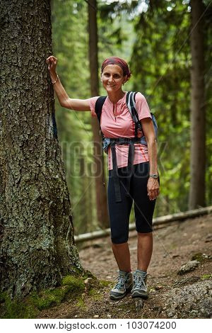 Full Length Portrait Of A Woman Hiker In The Woods