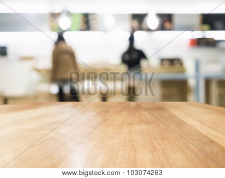Table Top With Blurred People And Shop Interior Background