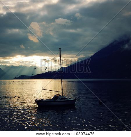 Yacht On Lake Como At The Sunset. Pleasure Boat.