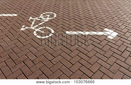 Bicycle Path On Red Pavement With Sign.