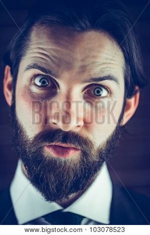 Close-up portrait of angry hipster