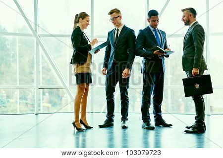 Business people asking and answering questions