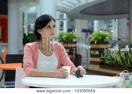 Young woman having a coffee-break