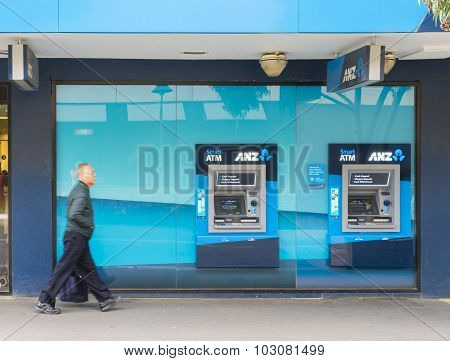 Elderly Man Walking Pass The Anz Bank