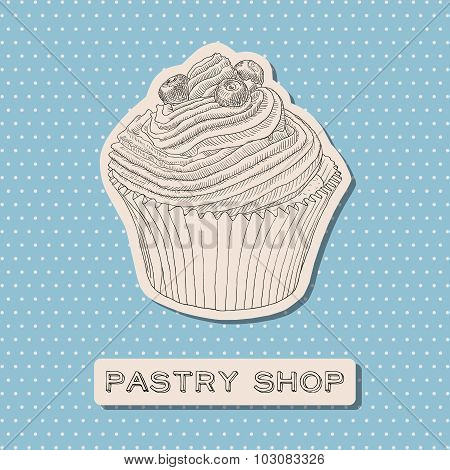 Hand drawn vector cupcake with berry.