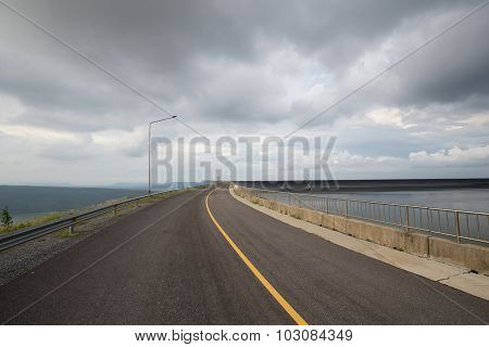 Road On The Ridge Of Lam Takong Reservoir Dam
