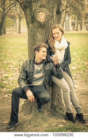 Modern Fashion Hipster Couple Of Young Lovers With Autumn Clothes - Deep Moment of a Love Story