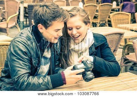 Couple Of Lovers Watching Photos On A Digital Camera