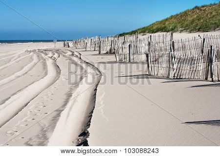 Tracks And Wooden Fences On The Beach