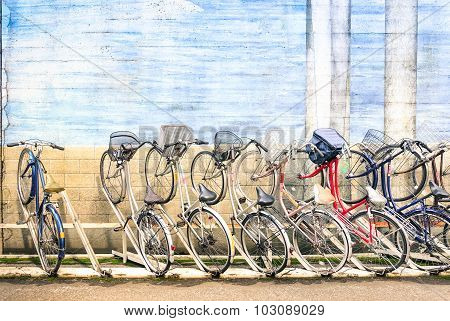 Multicolored Vintage Bicycles In Metal Rack In Tokyo City - Urban Ecological Transportation Concept