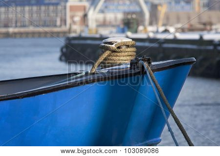Bow Of A Blue Ship Moored In Harbor