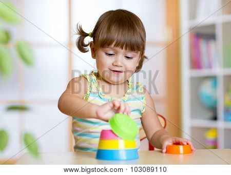 little child girl playing with educational toys