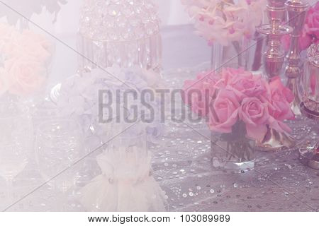 Wine Glass, Candlestick, Bunch Of Purple Hydrangea, Pink Rose And Crystal Ornament With Soft Focus A