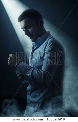 Young Businessman Dressing Up In Front Of Light Ray