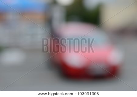 Background With Strongly Blurred Red Car